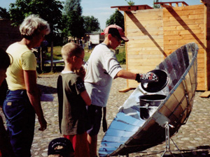 some students and their teacher with a solar cooker